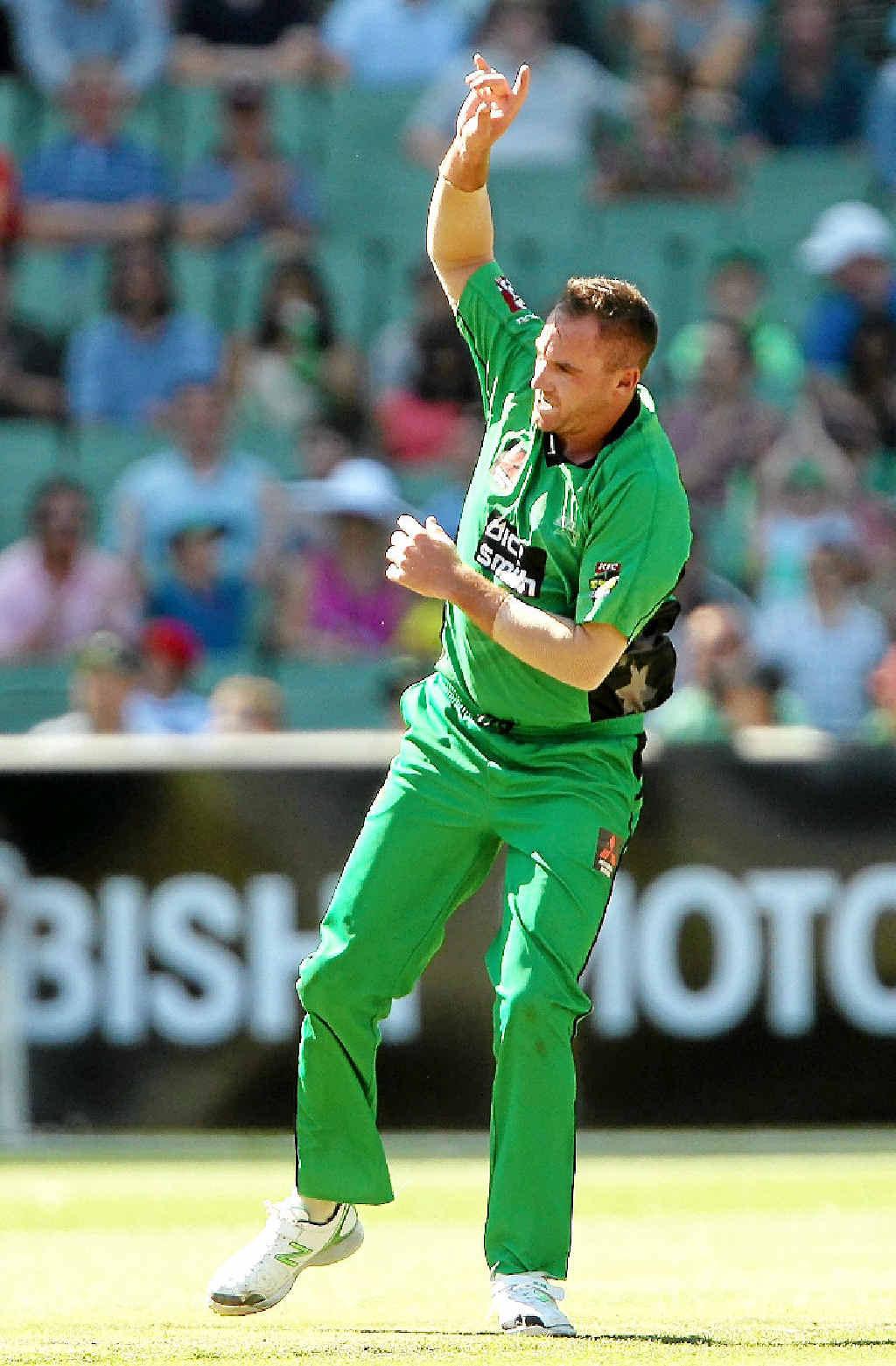 STAR PERFORMANCE: John Hastings celebrates taking the wicket of Scorchers batsman Ashton Turner at the MCG yesterday.