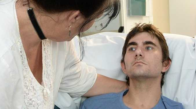 Dedicated mother Daphnejean Finnegan talks with her son Jamie at the Rockhampton Hospital. Photo: Chris Ison / The Morning Bulletin