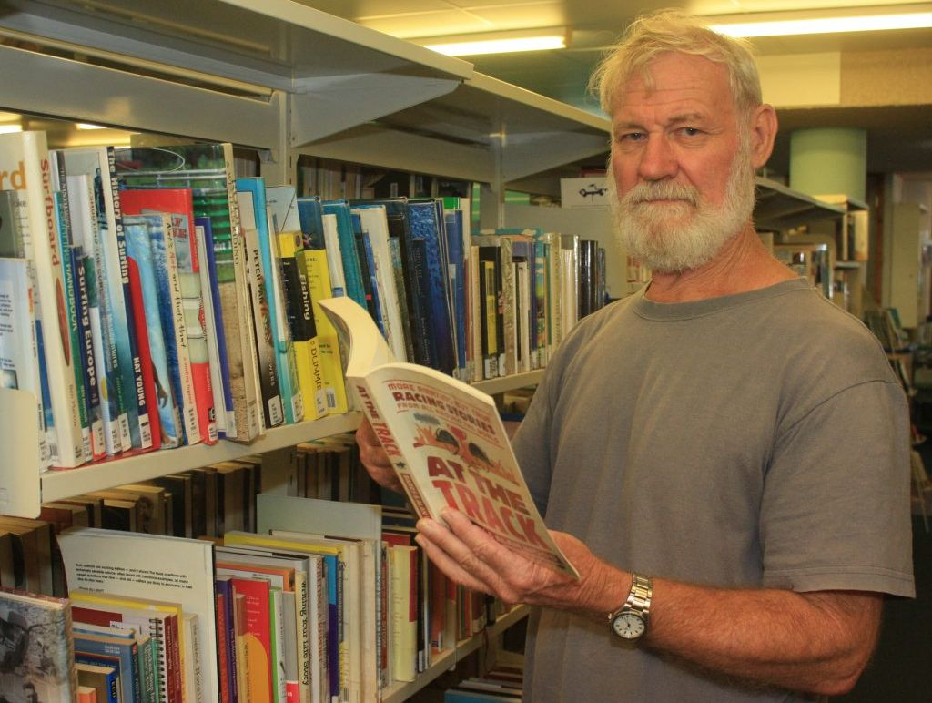 Bill Gifford from Yeppoon checks out a book at the Livingstone Shire Council library for free. He says it's absolutely unjust for Livingstone Shire residents to pay a $100 levy to borrow books from the Rockhampton Regional Council library.