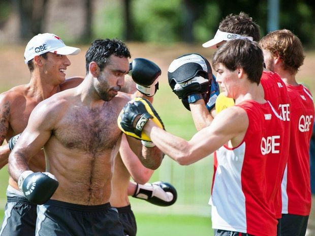 Dual Brownlow medalist, two-time premiership player and now Australian of the Year Adam Goodes works hard on the boxing pads while his Sydney Swans teammates sweat it out in an intra-club practice match at C.ex Coffs International Stadium. Photo: Rob Wright / The Coffs Coast Advocate