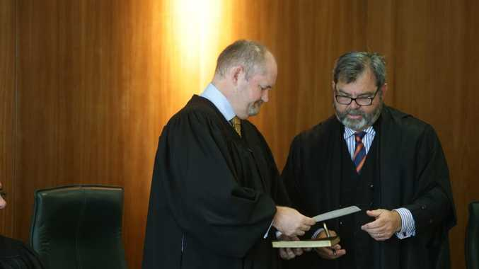 The swearing in of new Magistrate Simon Young (left) by Chief Magistrate Tim Carmody (right) at Brisbane Magistrates court.