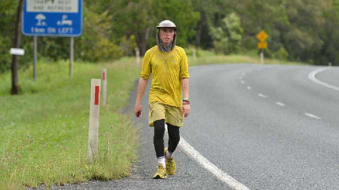 Jimmy Harrington walks along the Bruce Highway just north of Kuttabul, on his way into Mackay as part of his fundraising trek around Australia.
