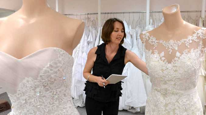 ON PARADE: Jill Burston for Brides sales assistant Tania Sanford organises the wedding gowns models will wear at Mackay's Premier Annual Bridal Fair at the MECC on Sunday.