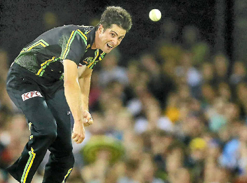Ben Cutting bowls during the Twenty20 International between Australia and the West Indies at the Gabba last February.
