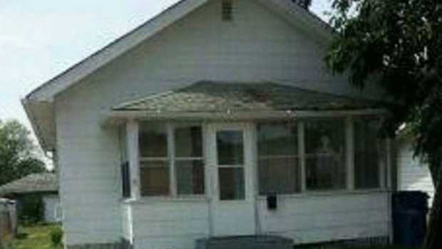 This image via the Hammond Police Department appears to show a figure at the window on the right side of the porch.