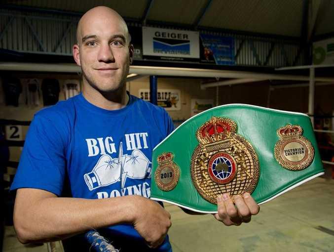 BIG BELT: Josh Webb shows off his Victorian state title belt.