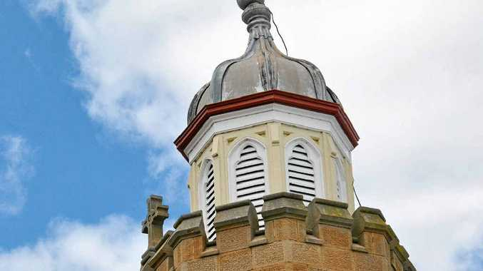 ACT OF GOD: The cross atop the Abbey of the Roses bell tower is on a lean after being struck by lightning.