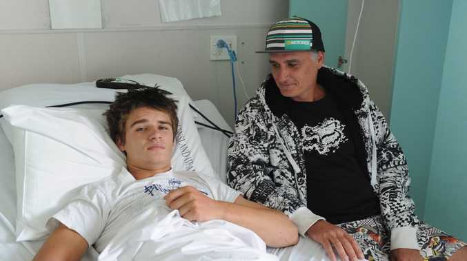 Seth Muller, 15, and his dad Shane from Maryborough now at Hervey Bay Hospital after Kingaroy Hospital failed to identify the seriousness of Seth's injuries.