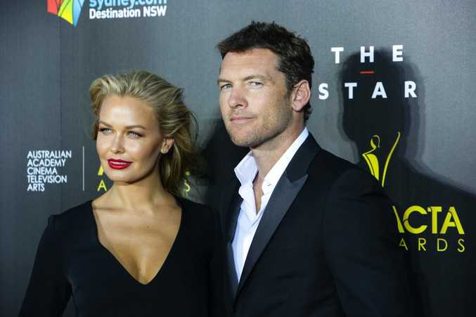 Lara Bingle and Sam Worthington on the AACTAs red carpet.