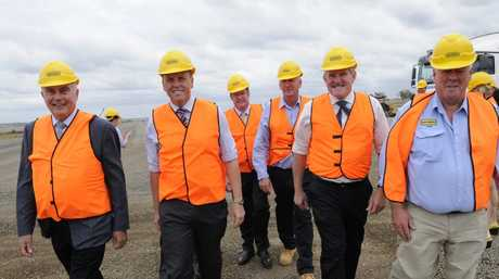 Touring the Wellcamp Airport construction site after yesterday's Toowoomba bypass announcement are (from left) Warren Truss, Scott Emerson, John McVeigh, Denis Wagner, Ian Macfarlane and John Wagner.