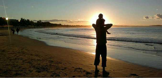 GONE: Greg Hutchings with daughter Eeva playing on the beach.