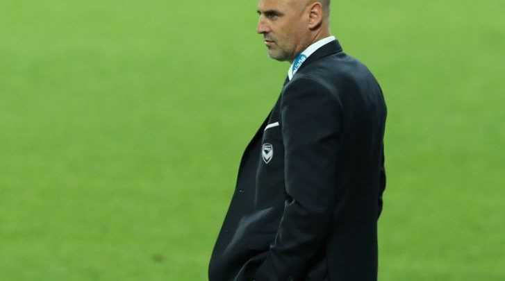 Melbourne Victory coach Kevin Muscat on the sideline during the round 13 A-League match between Melbourne Victory and Brisbane Roar at AAMI Stadium in Melbourne, Saturday, Jan. 4, 2014.