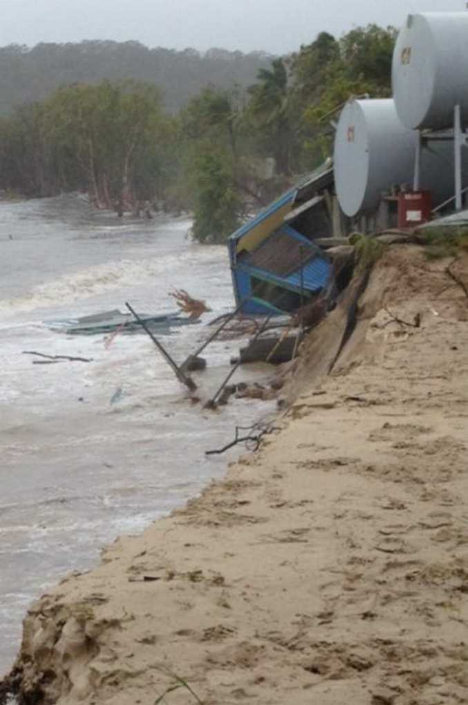 A shed at Great Keppel Island Hideaway falls to the sea as high tides batter Putney Beach.