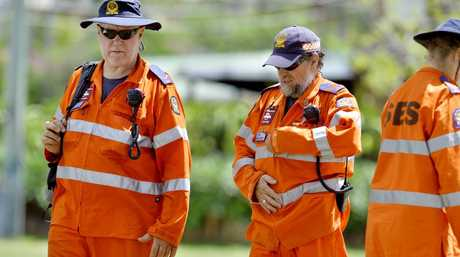 Tired SES volunteers make their way back to the marshalling location at Goupong Park after searching local bushland for missing woman Constance Cafarella. Photo: Claudia Baxter / The Queensland Times