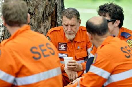 SES volunteers take a break at the marshalling point at Goupong Park after searching local bushland for missing woman Constance Cafarella. Photo: Claudia Baxter / The Queensland Times