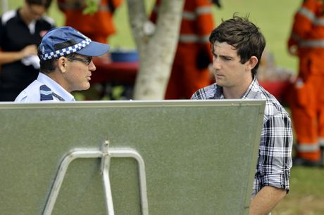 Andrew Scrivener, husband of missing person Constance Cafarella, speaks with Sergeant Paul Andrews at Goupong Park on Saturday, February 1. Photo: Claudia Baxter / The Queensland Times