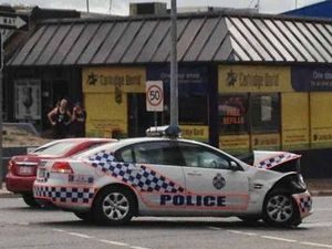 Pregnant driver shaken as cop car and 4WD crash in the CBD