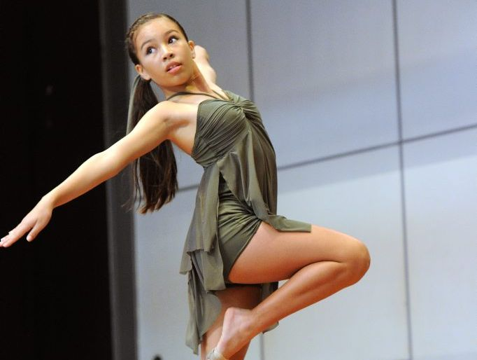 Jaya Wesche competing in the 11 years old category of the contemporary or free movement solo at the 2013 Gladstone Dance Festival, held at the Tannum Sands State High School hall.