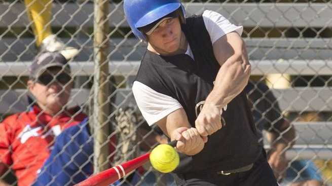 TAKING A SWING: Wade Codd attacks at the plate for Dodgers in their game against Warriors.