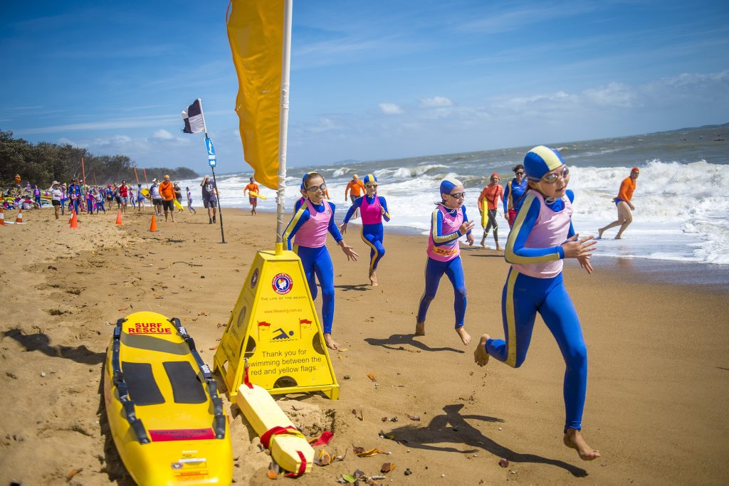 Under 10 nippers sprinting to the beach at the Tannum Sands Nippers.
