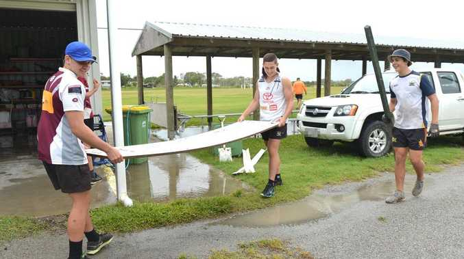 Cutters U16's Jacob Schill, Joel Hicks and Joshua Curti help clean up at the Mackay Juniro Rugby League Grounds. Photo Lee Constable / Daily Mercury