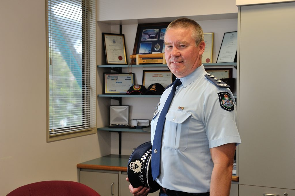 HATS OFF: Inspector Darren Somerville celebrates 30 years of continuous service with the police force.