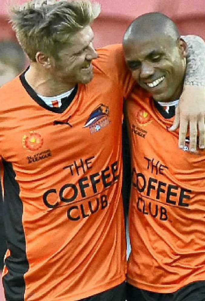 WELL DONE: Luke Brattan (left) gives Henrique a hug after the Brazilian scored the equaliser in yesterday's 2-1 win over Central Coast Mariners.