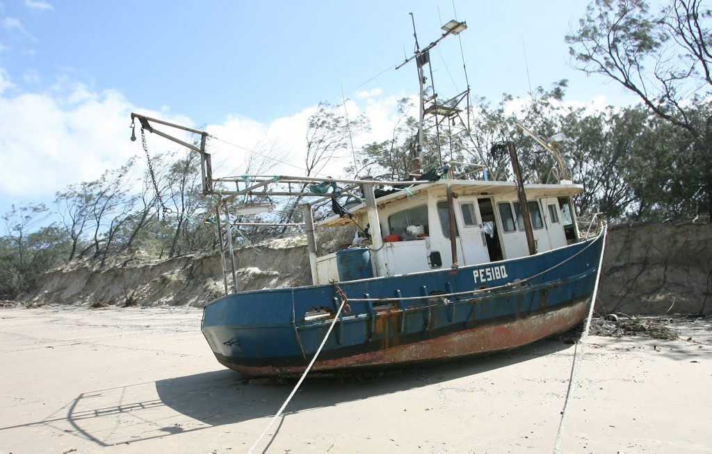 The Hervey Bay based trawler Rosella was unexpectedly found stranded on Farnborough Beach on Friday. Photo: Chris Ison / The Morning Bulletin