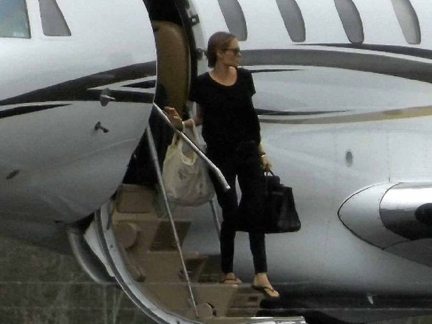 Hollywood actress Angelina Jolie steps off a plane at Whitsunday Coast Airport. The star is in town to direct her film Unbroken.