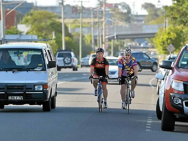 Local cyclists Barry Flutter and Garry Hill feel legislation enforcing a one metre clearance rule is overdue.