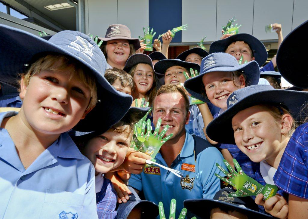 Titans NRL player Tom Kingston helping kids tackle bullying at Tweed St Josephs Primary School.