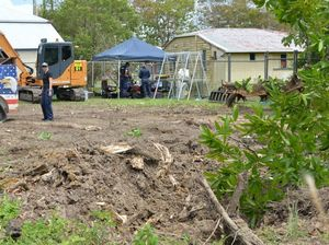 Police dig up backyard in 'cold case' search for teen