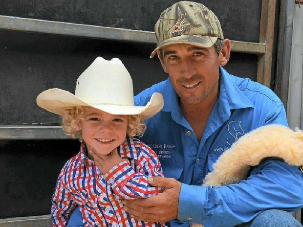 RODEO FAMILY: Scott Keogh and his two-year-old son Billy are getting keen for the Allora Show's rodeo tomorrow night.