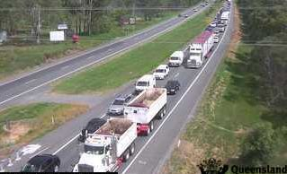 Traffic camera footage shows traffic slowing down on the Bruce Hwy.