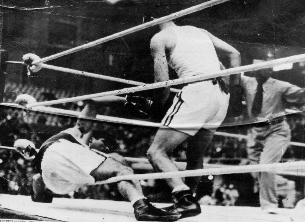 Adrian Holmes, knocks an opponent to the mat in the London Olympics, 1948