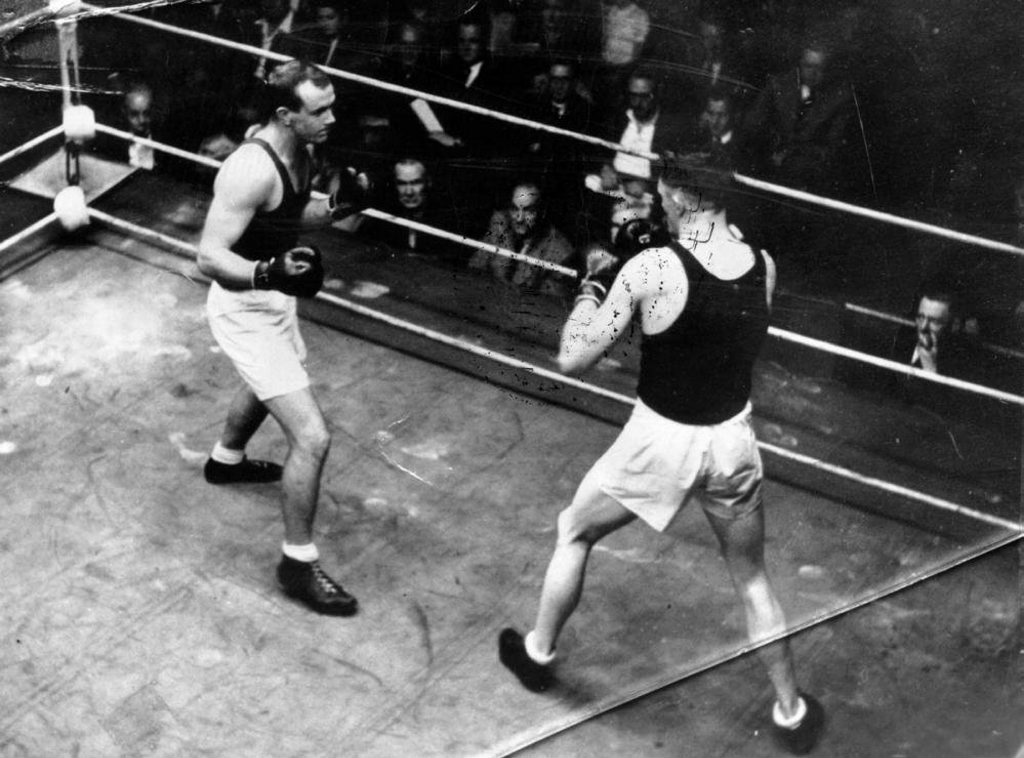 Adrian Holmes (left) boxing for Australia during the 1948 London Olympics.