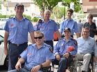 POSITIVE EXERCISE: Taking part in yesterday's Wheelchair Challenge in Mary St were (back to front) firefighters Andrew Walker and Martin Dorman, Steve Mullaly and Steven Artiemiew, Izaac and David Gibson and Judy Brauer and Rae Gate. The challenge sought to raise the profile of access issues for wheelchair users.