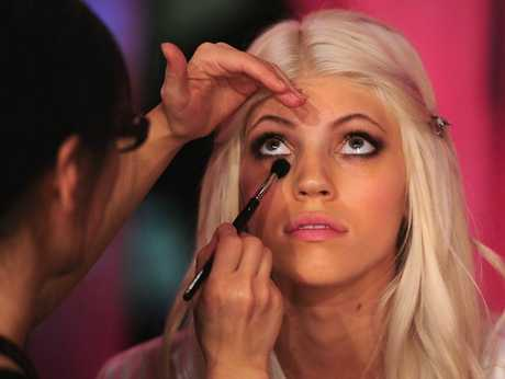 A model having make-up applied. File photo.