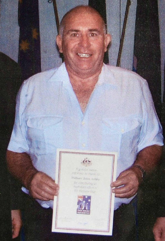 PROUD: Neville Irwin receives his Vietnam service appreciation certificate.