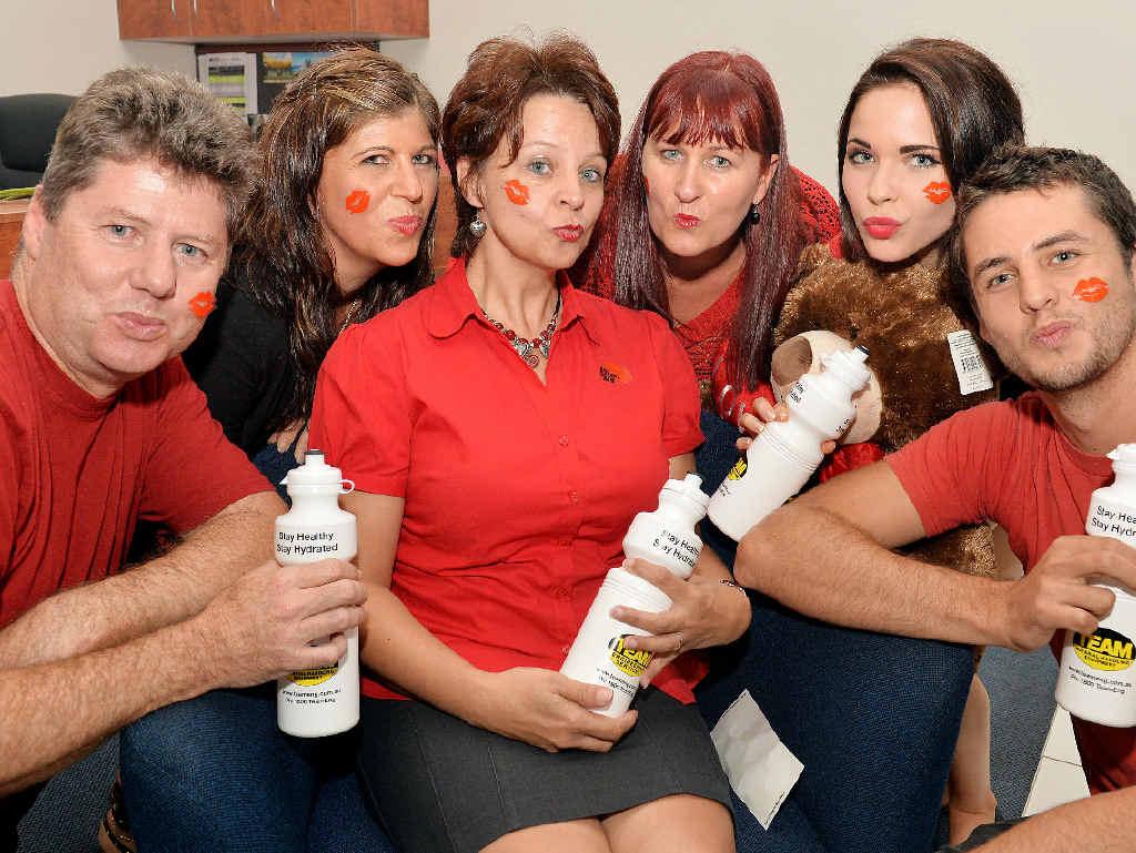 Charl Grobbelaar, Shellie Banks, Amanda Grobbelaar, Terri Lyons, Yvette Jreije and Ewan Grobbelaar pucker up as they prepare for a Valentine's Day fun run.