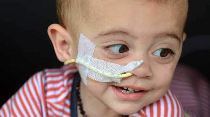 BRAVE TOT: Finn Smith has had a dreadful ordeal and he and his parents will need help.