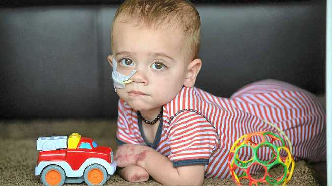 TAKE CARE: Brave young Finn Smith now faces a more certain future now that his parents have been granted carers' allowances.