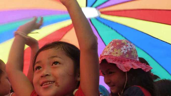 HELPING COMING: Orphans in Thailand have little.