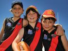 SERIOUS FUN: Darcy Drinkwater, Lachie Cottrill and Angus Killingbeck, Ballina Bombers players, enjoying the day at the AFL sign-on day at Byron Bay's sport centre.