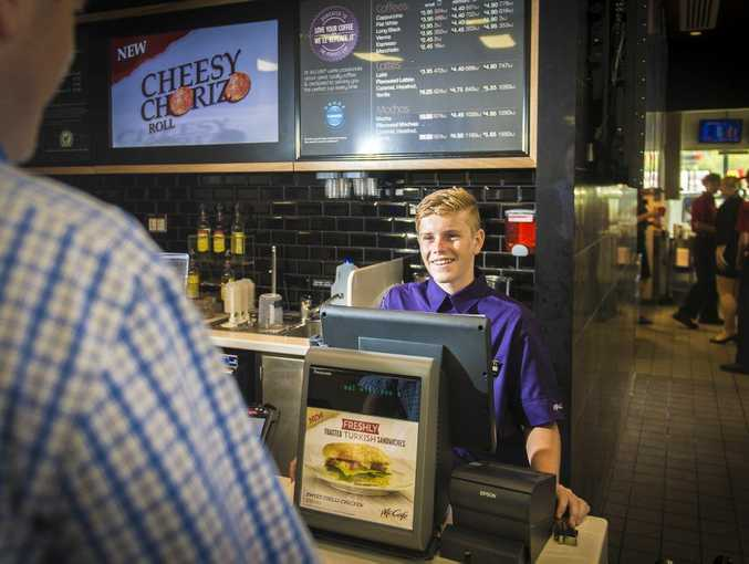 McDonald's employee Mason Collette, 15 serves a customer at the Calliope Travel Centre restaurant.