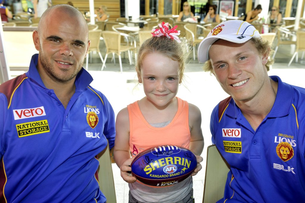 Brisbane Lions Ash McGrath and Ryan Lester with Sarah Foster