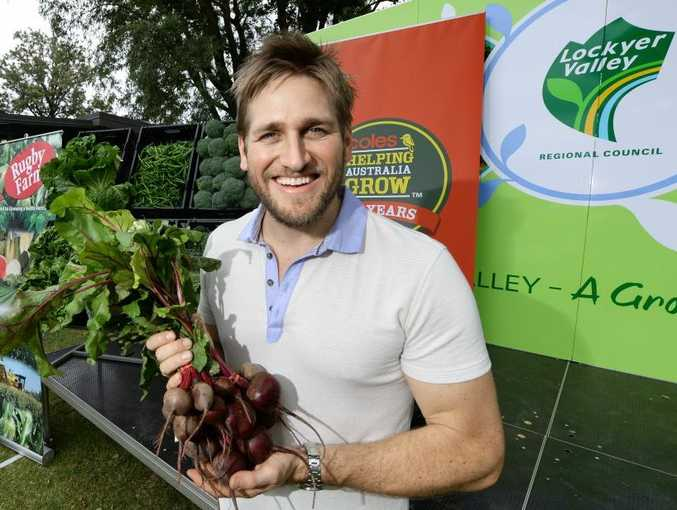 Curtis Stone visits Rugby Farm in Gatton as part of Coles Supermarket's centenary.