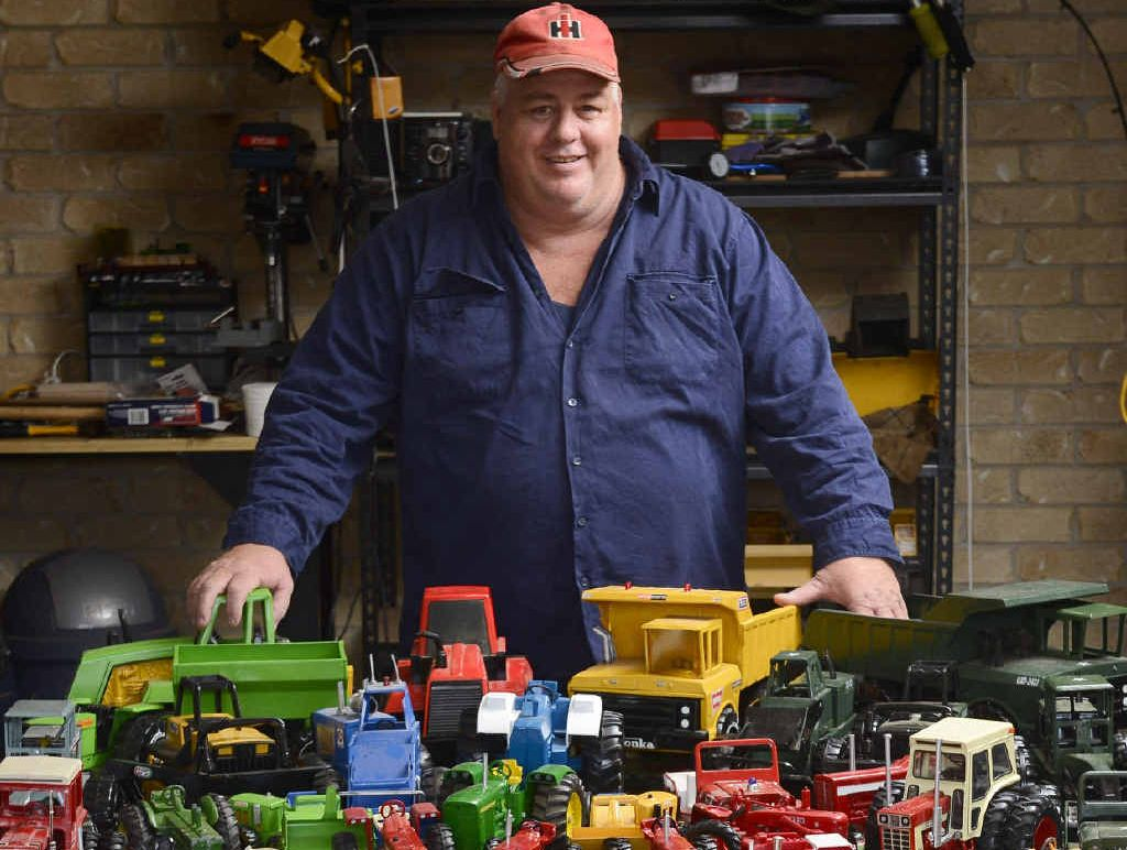 COLLECTOR: Geoff Mackenzie with his truck and tractor collection.
