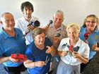 Rod Kamholtz, James Steele, Nance Davies, John Davies, Adele Hughes and Debbie Ward with the musical instruments they will donate to an orphanage in Kenya.