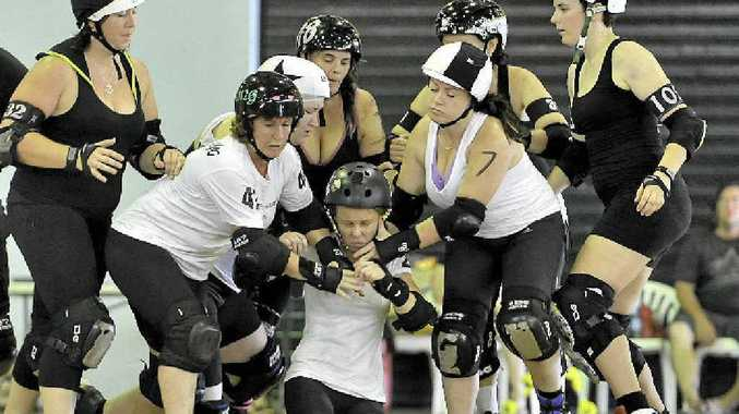 Sugar 'n' Strife takes a fall in a bout at Epic Scrim.